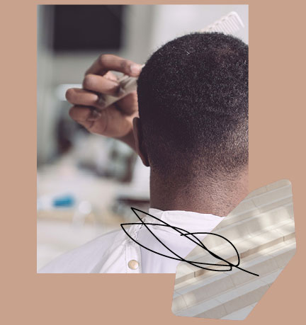 Man's hair being combed after cut